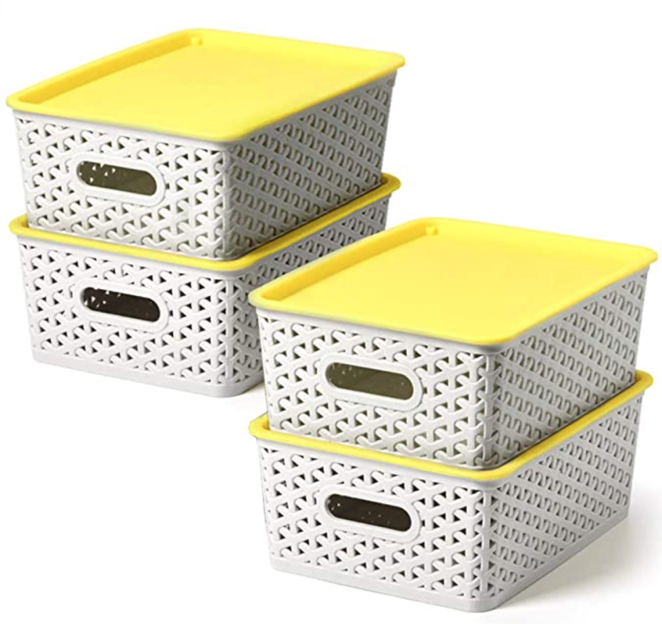 four containers with yellow lids