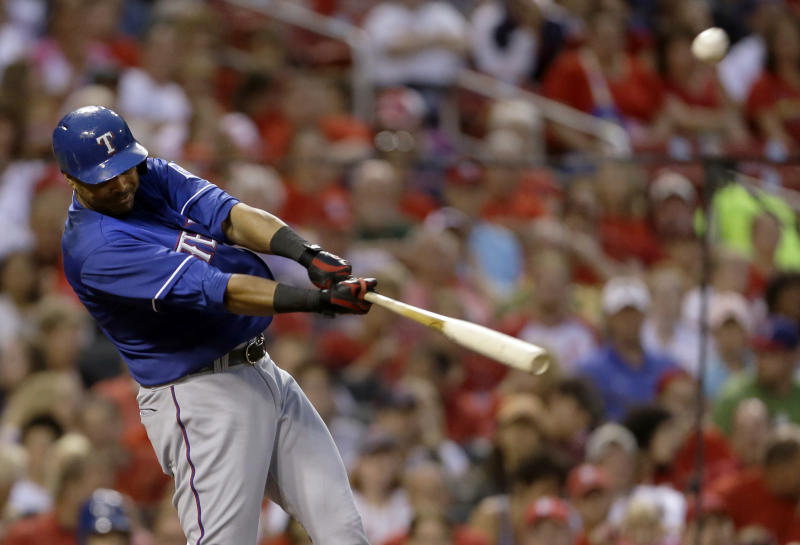 Texas Rangers' Nelson Cruz hits a two-run home run during the third inning of a baseball game against the St. Louis Cardinals on Saturday, June 22, 2013, in St. Louis. (AP Photo/Jeff Roberson)