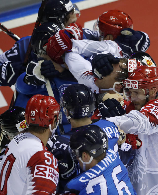 Players scrum during the Ice Hockey World Championships group A match between Finland and Denmark at the Steel Arena in Kosice, Slovakia, Thursday, May 16, 2019. (AP Photo/Petr David Josek)