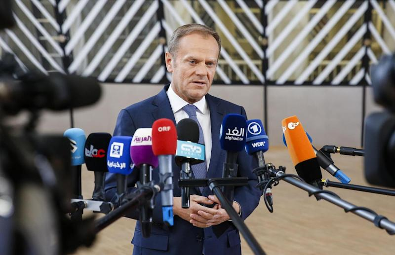 Donald Tusk speaks to the media as he arrives for a special European Summit in Brussels (EPA)