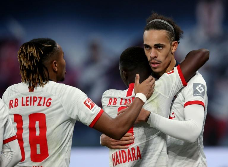Yussuf Poulsen celebrates scoring in RB Leipzig's 3-1 home win over Augsburg