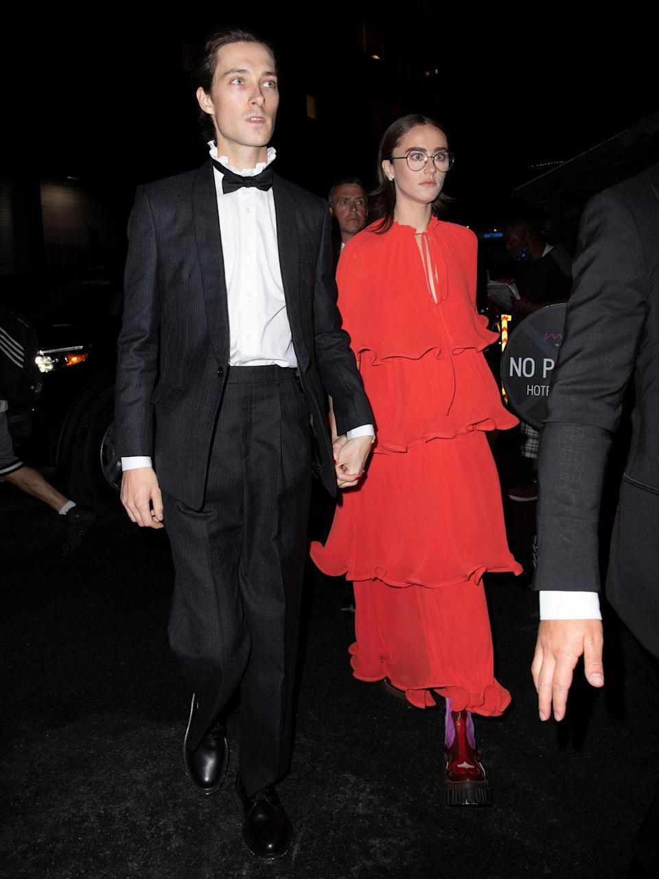 <p>Emhoff kept the red theme from the Met Gala going but changed into a layered dress. </p>
