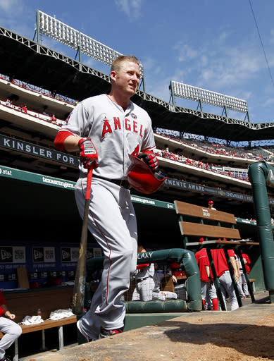 FILE - In this Sept. 29, 2013, file photo, Los Angeles Angels' Mark Trumbo (44) comes out of the dugout for his at-bat in a baseball game against the Texas Rangers in Arlington, Texas. The Arizona Diamondbacks have agreed to acquire Trumbo from the Angels as part of a three-team trade that also includes the Chicago White Sox, a person familiar with the talks told The Associated Press, Tuesday, Dec. 10, 2013. The person spoke on condition of anonymity because the trade had not yet been announced. (AP Photo/Tony Gutierrez, File)