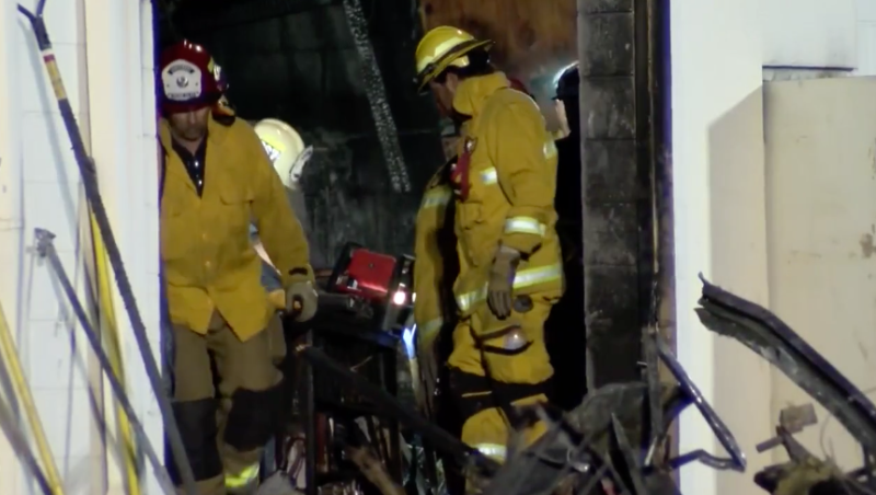 Firefighters are pictured inside Porterville Library after it was burnt in an act of arson.