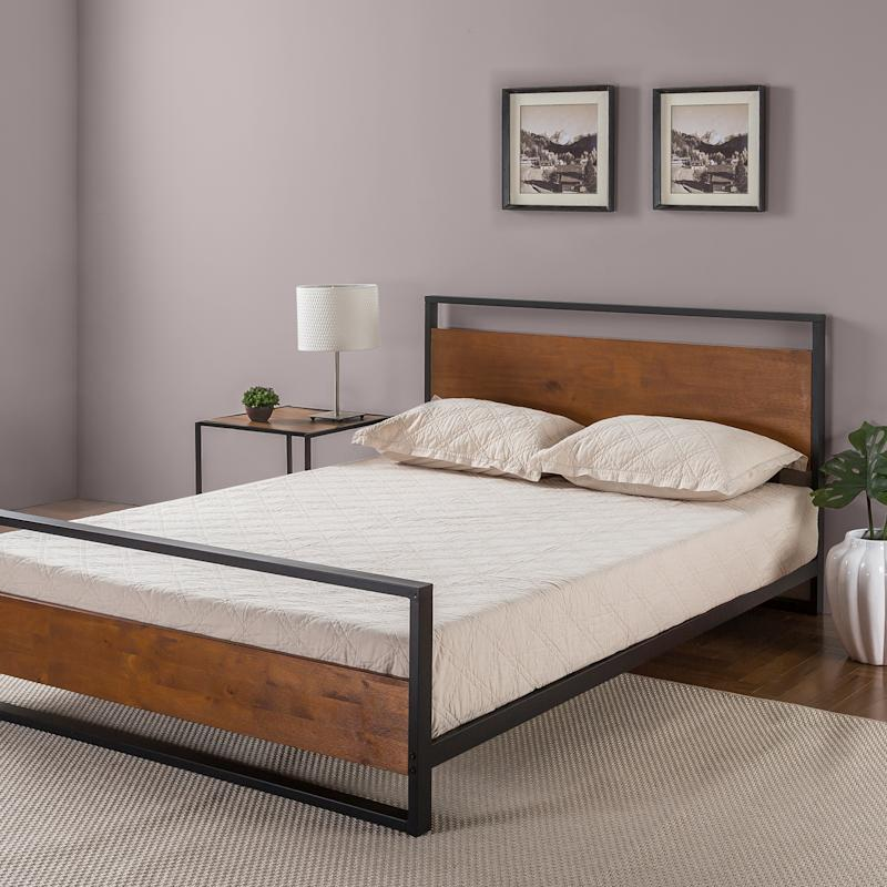 The mix of wood and metal makes this bed sleek and soothing at the same time. (Photo: Walmart)