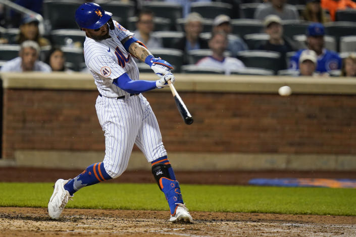 New York Mets' Kevin Pillar hits a two-run double during the fourth inning of a baseball game against the Chicago Cubs, Monday, June 14, 2021, in New York. (AP Photo/Frank Franklin II)