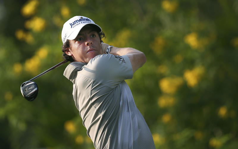 Rory McIlroy of Northern Ireland tees off on the tenth hole during the third round of the Singapore Open golf tournament at the Serapong Course at Sentosa Golf Club in Singapore on Sunday, Nov. 11, 2012. (AP Photo/Wong Maye-E)