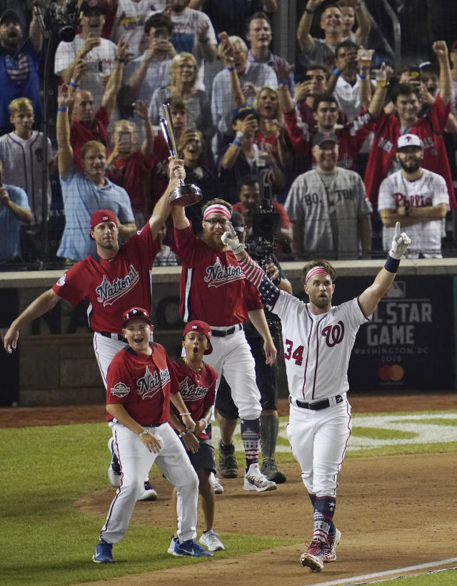 Washington Nationals Bryce Harper reacts to his last home run to win the the Major League Baseball Home Run Derby, Monday, July 16, 2018 in Washington. The 89th MLB baseball All-Star Game will be played Tuesday. (AP Photo/Carolyn Kaster)