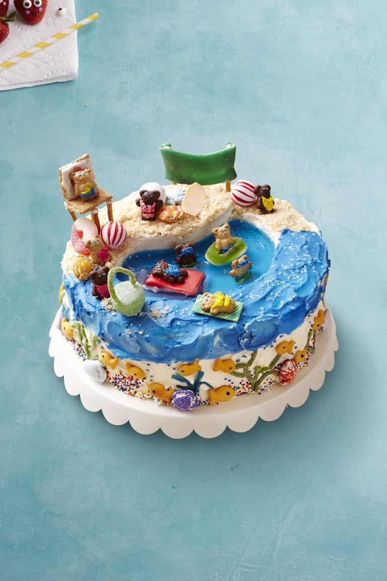 """<p>This cake is so playful and fun that it would be probably be a beloved option for an adult or kids birthday party, particularly if its beach or ocean-themed. </p><p><em><strong><a href=""""https://www.womansday.com/food-recipes/food-drinks/recipes/a54842/beach-cake-recipe/"""" rel=""""nofollow noopener"""" target=""""_blank"""" data-ylk=""""slk:Get the Beach Cake recipe."""" class=""""link rapid-noclick-resp"""">Get the Beach Cake recipe.</a></strong></em></p>"""