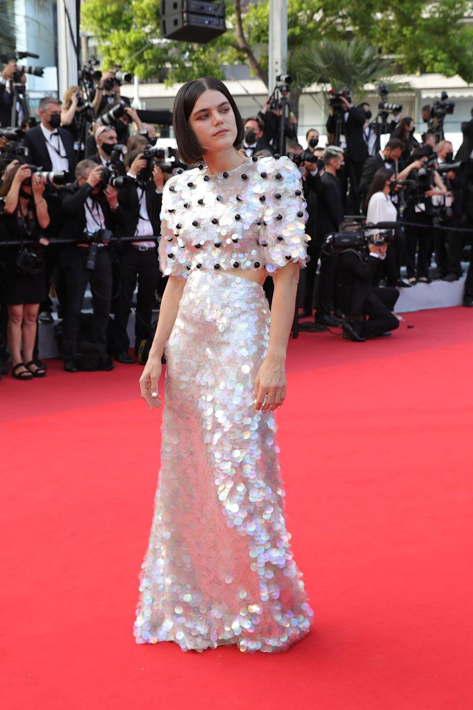 <p>Wearing a sparkly Gucci dress.</p>