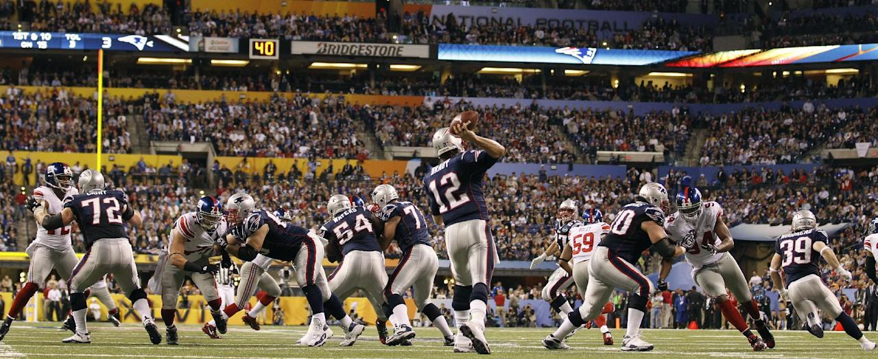 New England Patriots quarterback Tom Brady (12) passes against the New York Giants during the first half of the NFL Super Bowl XLVI football game, Sunday, Feb. 5, 2012, in Indianapolis. (AP Photo/Paul Sancya)