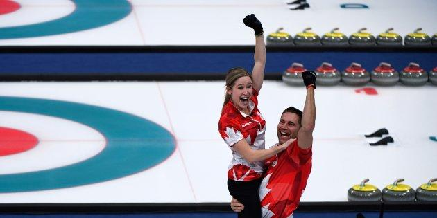 Canada's Kaitlyn Lawes and John Morris celebrate winning the curling mixed doubles gold medal game.