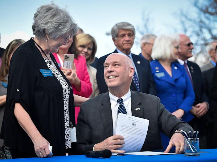 Republican Gov. Greg Gianforte smiles at Rep. Sharon Greef, R-Florence, during the signing of a bill in Helena, Mont. Monday, April 26, 2021.  (AP)