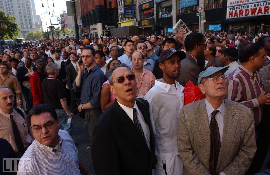 <p>Getty photographer Spencer Platt's picture of a crowd in Lower Manhattan watching the twin towers burn captures, in one instant, the profound disbelief that held sway in the city and around the world — a disbelief that inevitably turned to mingled rage, grief, and fear as the scale and the nature of the attack on the country gradually became clear. Here, in a sense, is a portrait of the terrorists' true target: young and old, men and women, civilians of countless races and, no doubt, countless creeds who were, mysteriously, spared, only to bear witness. <br /><br />(Photo: Spencer Platt/Getty Images)<br /><br /><br /></p>