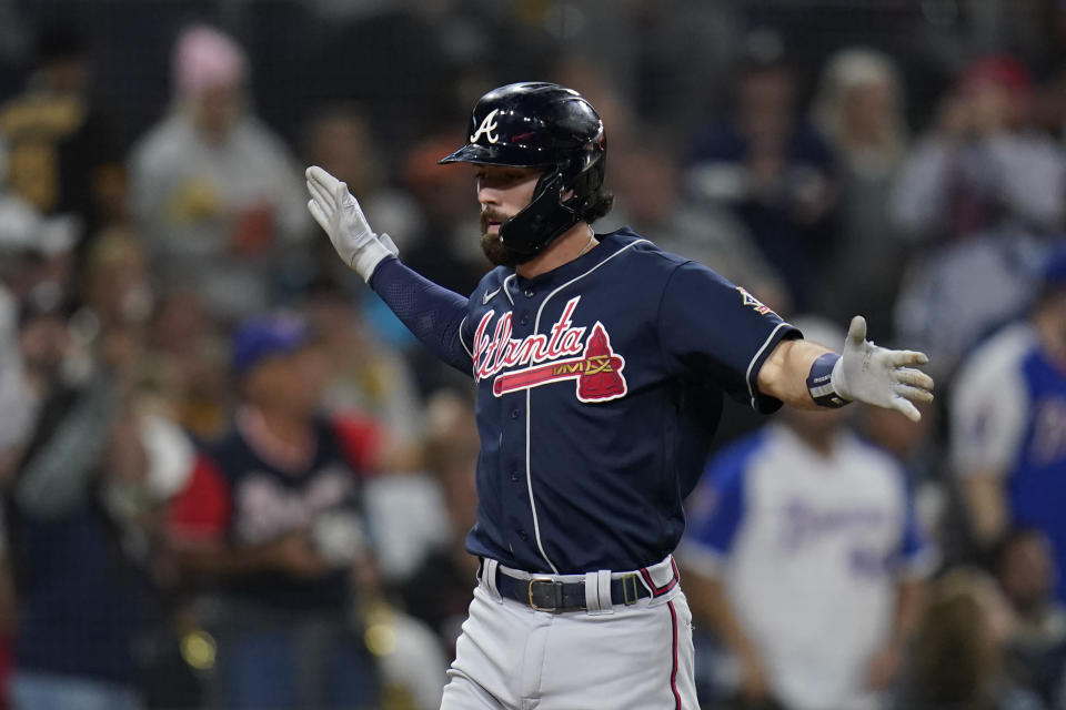 Atlanta Braves' Dansby Swanson reacts after hitting a two-run home run during the second inning of a baseball game against the San Diego Padres, Friday, Sept. 24, 2021, in San Diego. (AP Photo/Gregory Bull)