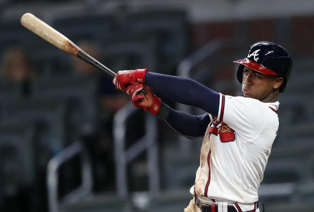 Atlanta Braves' Ozzie Albies drives in the winning run with a double in the 11th inning of the team's baseball game against the Pittsburgh Pirates early Thursday, June 13, 2019, in Atlanta. The Braves won 8-7. (AP Photo/John Bazemore)