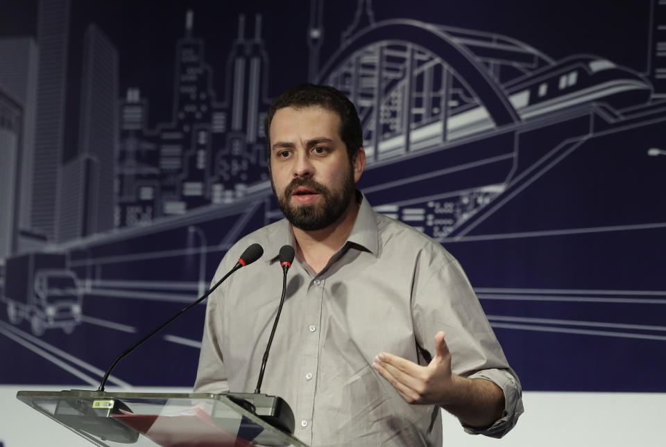 Presidential candidate Guilherme Boulos, representing the Liberty and Socialism Party, speaks at the Brazilian Association of Infrastructure and Basic Industries (ABDIB) forum, in Sao Paulo, Brazil, Monday, Aug. 20, 2018. Brazil will elect a new president on Oct. 7. (AP Photo/Andre Penner)