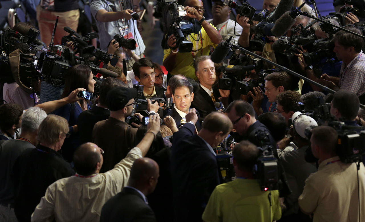 Sen. Marco Rubio, R-Fla., is surrounded by reporters during a tour of the convention floor at the Republican National Convention in Tampa, Fla., on Wednesday, Aug. 29, 2012. (AP Photo/J. Scott Applewhite)