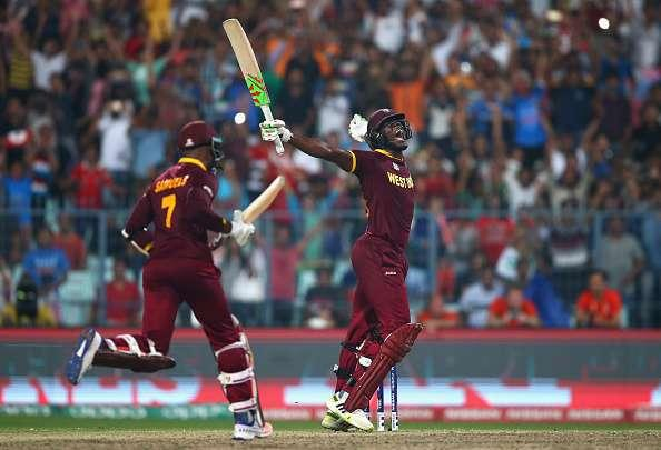 KOLKATA, WEST BENGAL - APRIL 03: Carlos Brathwaite of the West Indies celebrates hitting the winning runs during the ICC World Twenty20 India 2016 Final match between England and West Indies at Eden Gardens on April 3, 2016 in Kolkata, India. (Photo by Ryan Pierse/Getty Images)