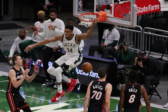 Giannis Antetokounmpo #34 of the Milwaukee Bucks reacts to a dunk against the Miami Heat during the first half of a game at Fiserv Forum on May 15, 2021 in Milwaukee, Wisconsin. NOTE TO USER: User expressly acknowledges and agrees that, by downloading and or using this photograph, User is consenting to the terms and conditions of the Getty Images License Agreement. (Photo by Stacy Revere/Getty Images)