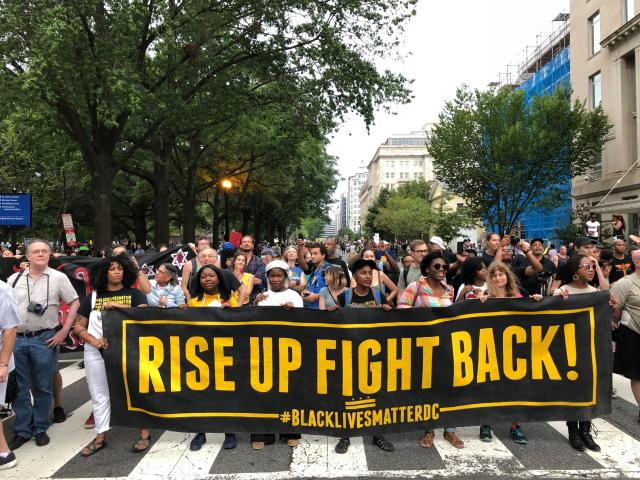 <p>Protestors march against the far-right's Unite the Right rally August 12, 2018 in Washington, DC on the one-year anniversary of deadly violence at a similar protest in Charlottesville, Virginia. – Last year's protests in Charlottesville, Virginia, that left one person dead and dozens injured, saw hundreds of neo-Nazi sympathizers, accompanied by rifle-carrying men, yelling white nationalist slogans and wielding flaming torches in scenes eerily reminiscent of racist rallies held in America's South before the Civil Rights movement. (Photo: Daniel Slim/AFP/Getty Images) </p>