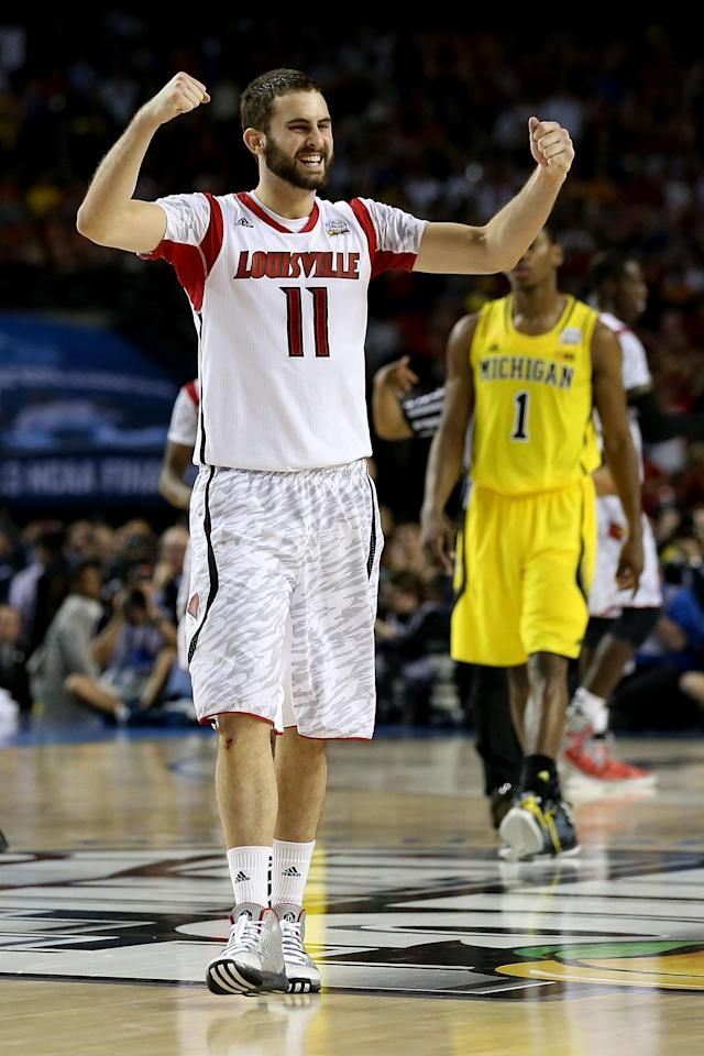 Luke Hancock #11 of the Louisville Cardinals celebrates their 82-76 win against the Michigan Wolverines during the 2013 NCAA Men's Final Four Championship at the Georgia Dome on April 8, 2013 in Atlanta, Georgia. (Photo by Streeter Lecka/Getty Images)