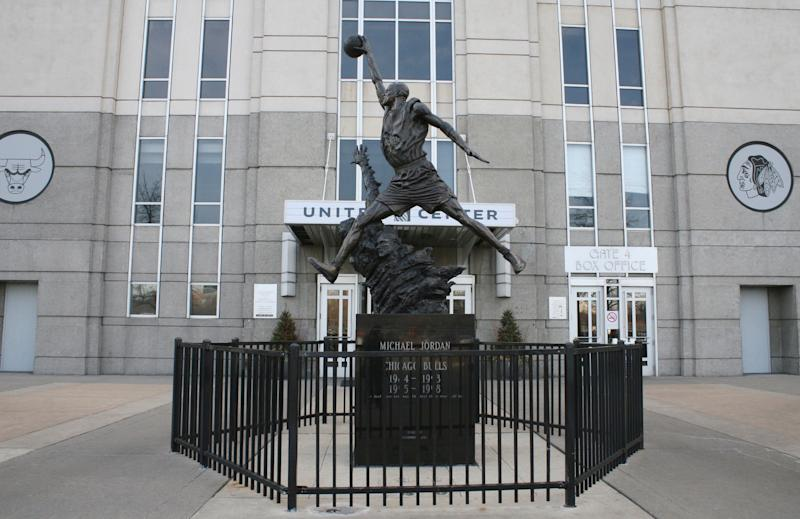 "In this photo taken Feb. 28, 2012, a statue of former Chicago Bulls star Michael Jordan stands outside the United Center arena in Chicago. The ""sneakerhead"" craze started back in the late 1980s with the release of the first Nike Air Jordan shoe. People who track the shoe culture say the Internet and explosion of social networking has created new fervor for the hobby which resulted in riots in some cities during the release of some limited edition shoes in recent weeks. (AP Photo/Martha Irvine)"