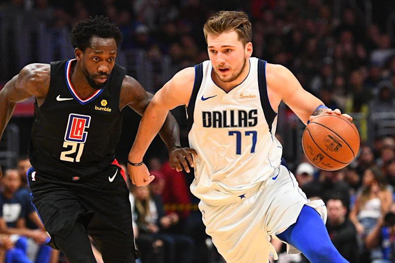 LOS ANGELES, CA - FEBRUARY 25: Dallas Mavericks Guard Luka Doncic (77) drives past Los Angeles Clippers Guard Patrick Beverley (21) during a NBA game between the Dallas Mavericks and the Los Angeles Clippers on February 25, 2019 at STAPLES Center in Los Angeles, CA. (Photo by Brian Rothmuller/Icon Sportswire via Getty Images)