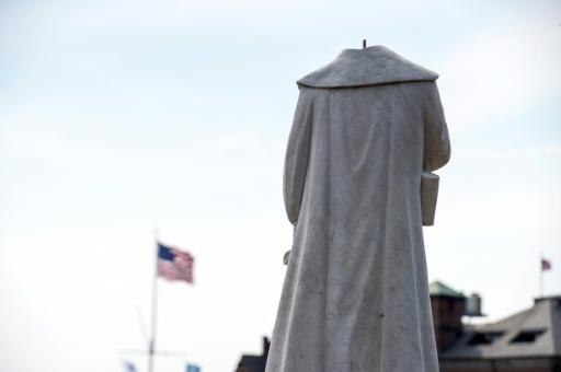 A decapitated statue of Christopher Columbus in Boston, Massachusetts