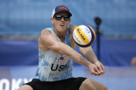 Tri Bourne, of the United States, returns a shot during a men's beach volleyball match against Switzerland at the 2020 Summer Olympics, Wednesday, July 28, 2021, in Tokyo, Japan. (AP Photo/Felipe Dana)