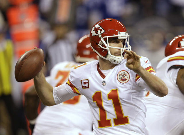Kansas City Chiefs quarterback Alex Smith (11) throws against the Indianapolis Colts during the first half of an NFL wild-card playoff football game Saturday, Jan. 4, 2014, in Indianapolis. (AP Photo/Michael Conroy)