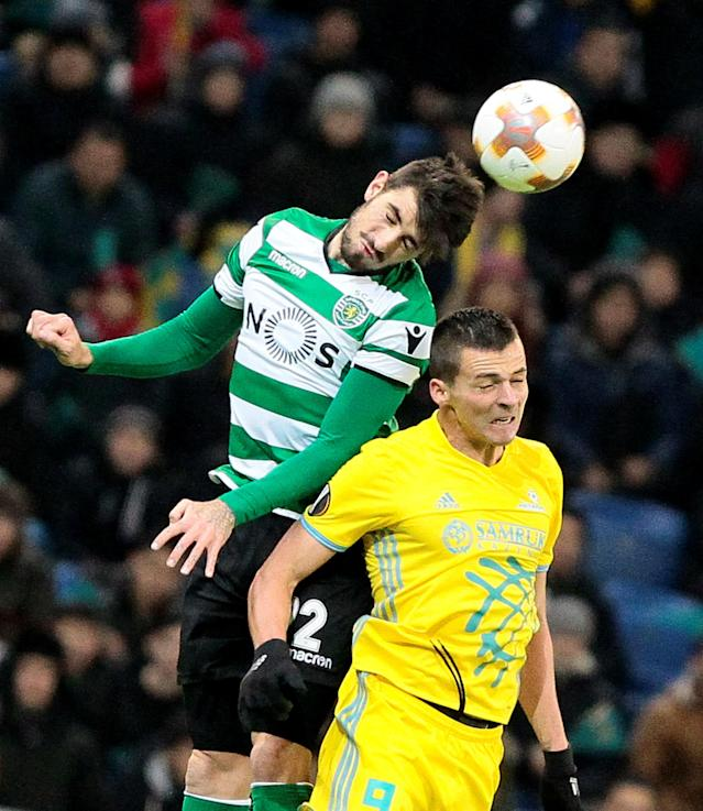 Soccer Football - Europa League Round of 32 First Leg - Astana vs Sporting CP - Astana Arena, Astana, Kazakhstan - February 15, 2018 Sporting's Cristiano Piccini in action with Astana's Djordje Despotovic REUTERS/Alexei Filippov