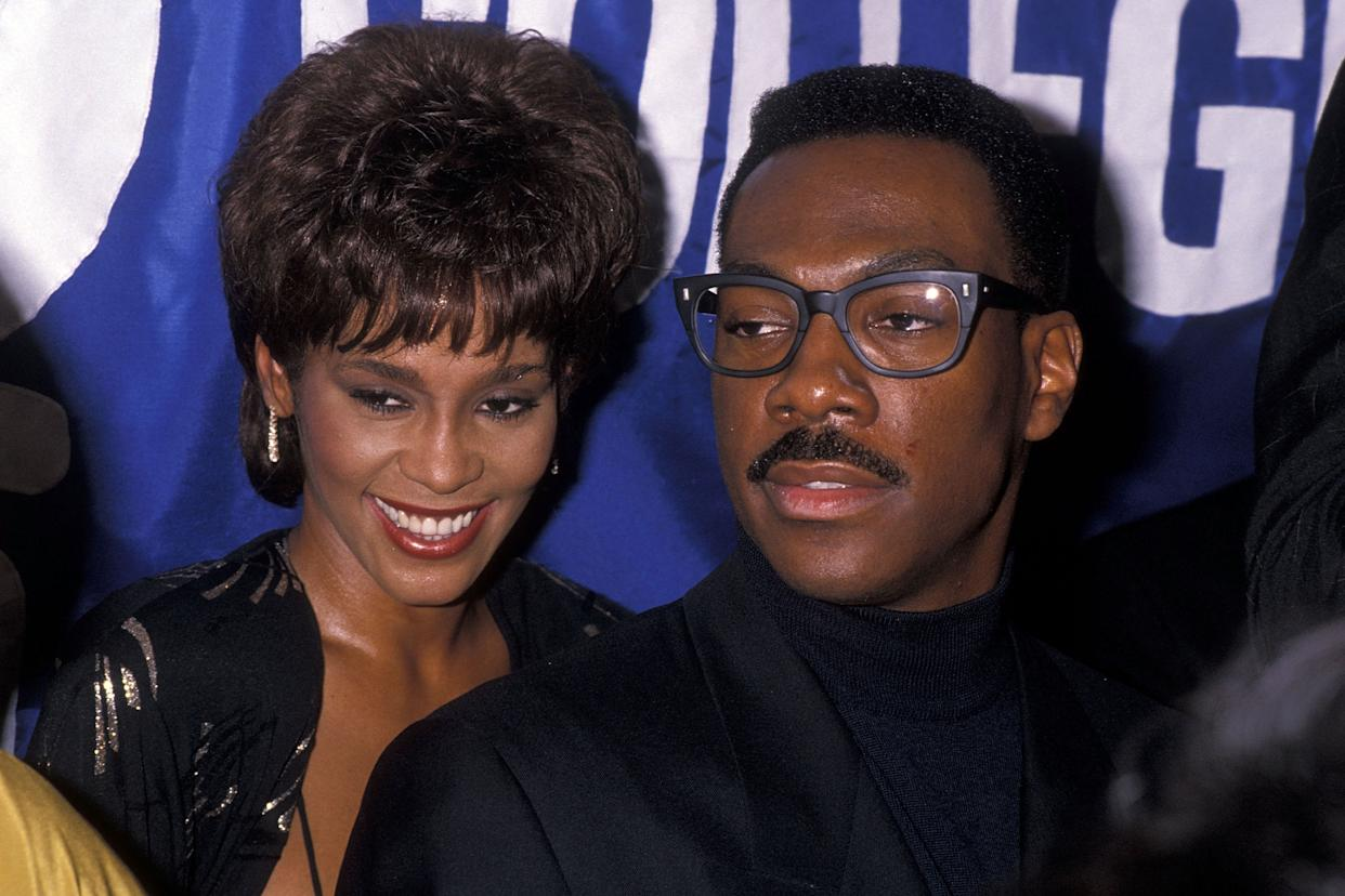 """Singer Whitney Houston and comedian/actor Eddie Murphy attend the United Negro College Fund's 10th Annual """"Lou Rawls Parade of Stars"""" Telethon Kick-Off Party on November 15, 1989 at L'Ermitage in Beverly Hills, California. (Photo by Ron Galella, Ltd./Ron Galella Collection via Getty Images)"""