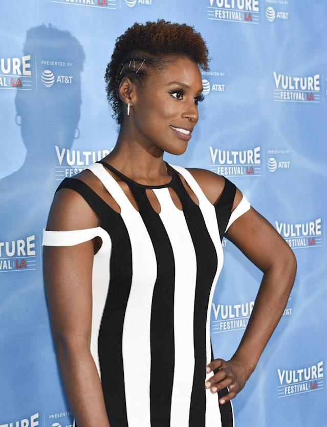 <p>Try Issa Rae's side-braided frohawk look. Take it to the next level like she did, by intertwining gold string. (Photo: Getty Images) </p>