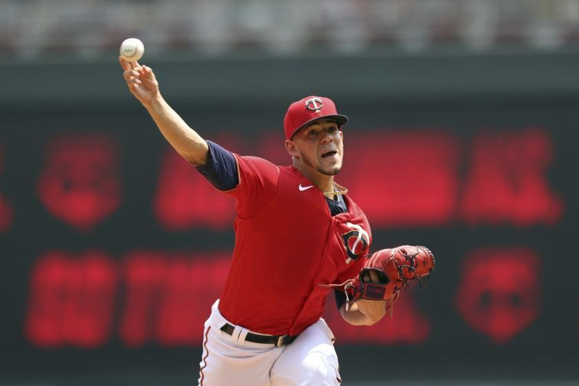 Minnesota Twins' pitcher Jose Berrios throws against the Detroit Tigers during the first inning of a baseball game, Sunday, July 11, 2021, in Minneapolis. (AP Photo/Stacy Bengs)