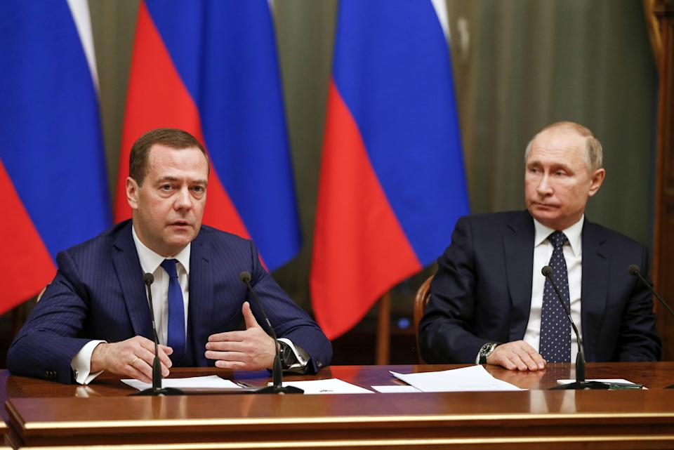 MOSCOW, RUSSIA - DECEMBER 26, 2018: Russia's Prime Minister Dmitry Medvedev (L) and Russia's President Vladimir Putin during Putin's end-of-year meeting with members of the Russian Government. Dmitry Astakhov/Russian Government Press Office/TASS (Photo by Dmitry Astakhov\TASS via Getty Images)
