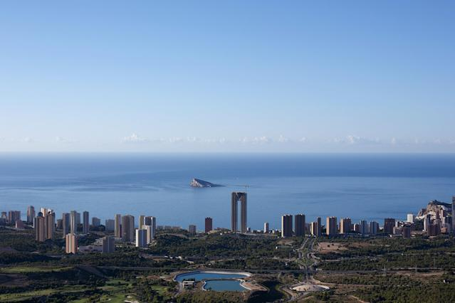 """BENIDORM, SPAIN - AUGUST 09: A general view shows the unfinished InTempo building on August 9, 2013 in Benidorm, Spain. The construction of the In Tempo building began during the economic boom and was meant open in 2009 as the tallest residential building within the E.U. at almost 200 metres high. However after a catalogue of building problems the 47-story twin tower building remains unfinished and has been transferred to the SAREB or """"Bad Bank"""". (Photo by Pablo Blazquez Dominguez/Getty Images)"""