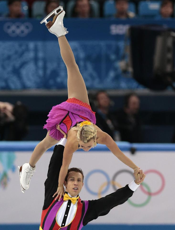 Kirsten Moore-Towers and Dylan Moscovitch of Canada compete in the pairs short program figure skating competition at the Iceberg Skating Palace during the 2014 Winter Olympics, Tuesday, Feb. 11, 2014, in Sochi, Russia. (AP Photo/Ivan Sekretarev)