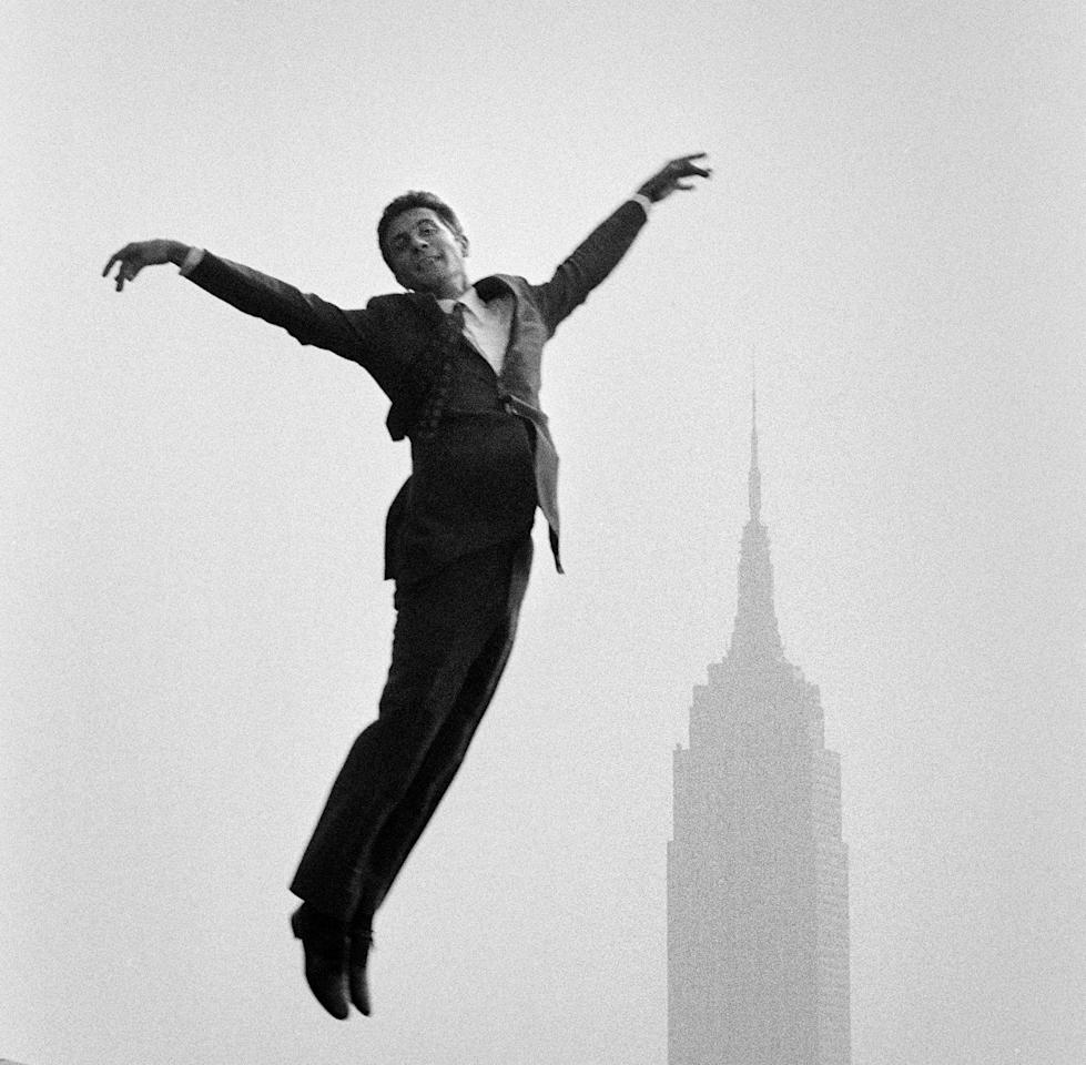 "<p>French singer Gilbert Bécaud jumps with arms outstretched near the Empire State Building in New York.(Photo: ""New York City Up and Down"" by Jean-Pierre Laffont, copyright © 2017, published by Glitterati Inc. <a rel=""nofollow"" href=""https://glitteratiincorporated.com"">https://glitteratiincorporated.com</a>) </p>"