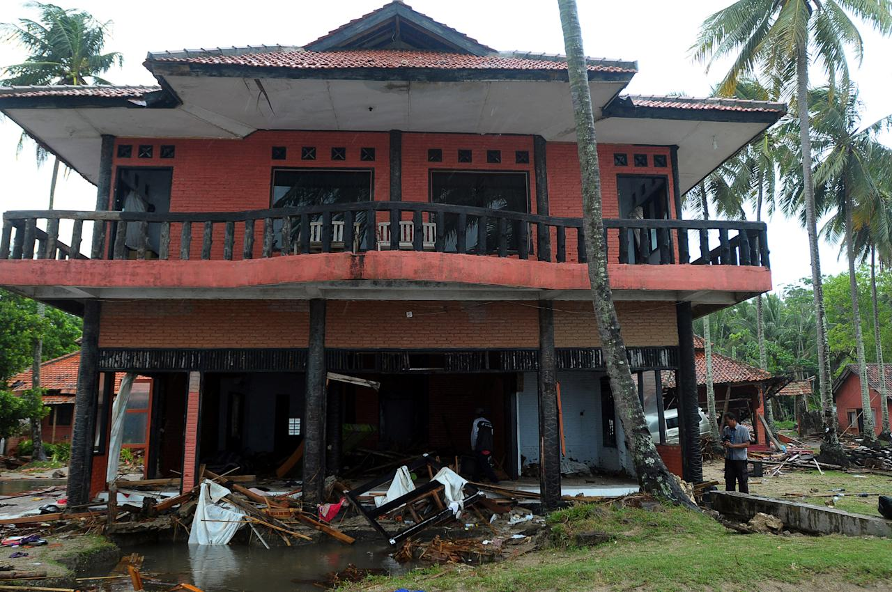 <p>This home has been devastated as the deluge struck, smashing windows and gutting the property. </p>