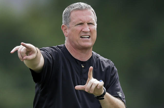 FILE - In this Aug. 5, 2014, file photo, then-Detroit Lions linebackers coach Bill Sheridan directs the team through drills during an NFL football training camp in Allen Park, Mich. Sheridan arrived at Boston College in the spring of 2018 as the linebackers coach after spending the previous 13 years in the NFL. (AP Photo/Carlos Osorio, File)
