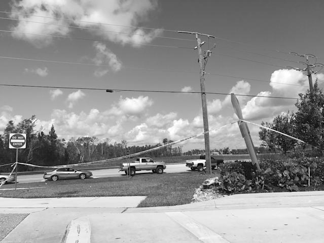 <p>Cars wait in a line that extended miles at one of the few gas stations open in the aftermath of Hurricane Irma in Fort Myers, Fla., a region hit by massive fuel shortages. (Photo: Holly Bailey/Yahoo News) </p>