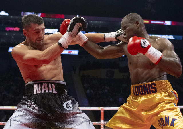 Oleksandr Gvozdyk (L) lands a right on Adonis Stevenson during their light heavyweight WBC championship fight Saturday in Quebec City. Gvozdyk won by knockout. (AP)