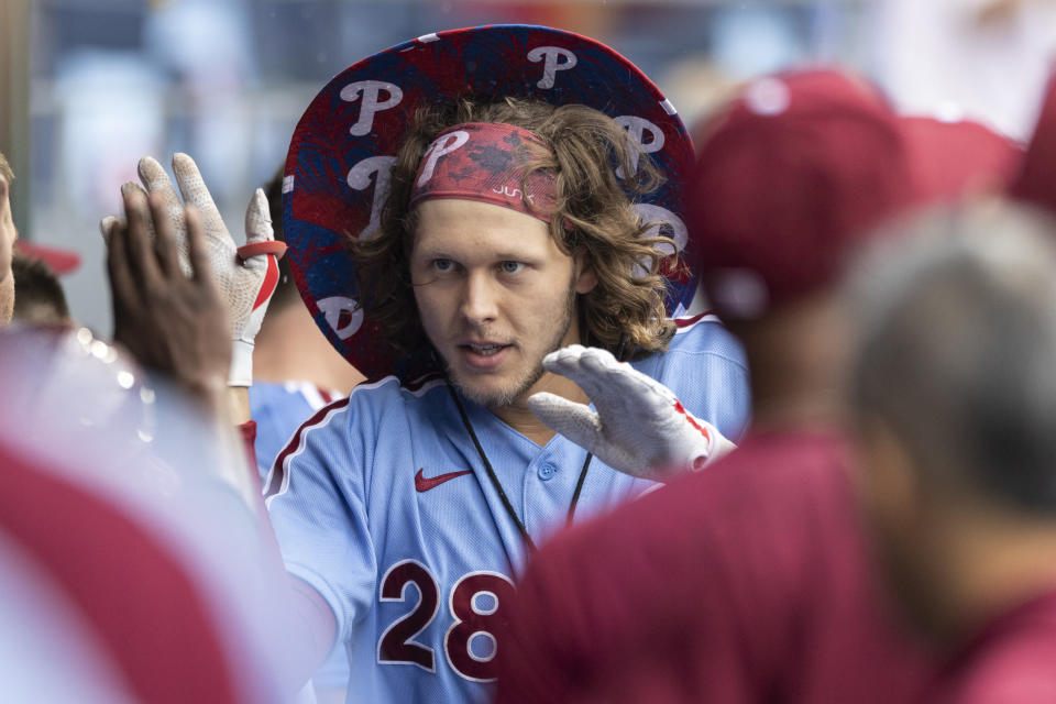 Philadelphia Phillies' Alec Bohm celebrates in the dugout after hitting a home run during the fourth inning of a baseball game against the Washington Nationals, Thursday, July 29, 2021, in Philadelphia in the second game of a doubleheader. (AP Photo/Laurence Kesterson)