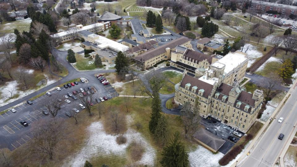 This aerial image taken with a drone shows the School Sisters of Notre Dame Central Pacific Province, Thursday, Dec. 17, 2020, in Elm Grove, Wis. Eight nuns living in the suburban Milwaukee covent have died in the last week from COVID-19, according to the congregation. (AP Photo/Morry Gash)