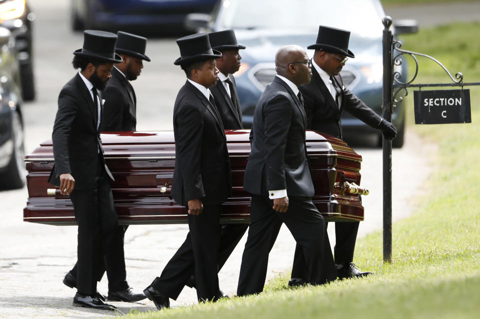 FILE - In this Saturday, April 4, 2020 file photo, pallbearers carry the casket of The Rev. Joseph E. Lowery at the Westview cemetery in Atlanta. Lowery, 98, a veteran civil rights leader, helped the Rev. Martin Luther King Jr. found the Southern Christian Leadership Conference and fought against racial discrimination. Lowery led the SCLC for two decades and received the Presidential Medal of Freedom during the Obama presidency. (AP Photo/John Bazemore, Pool)