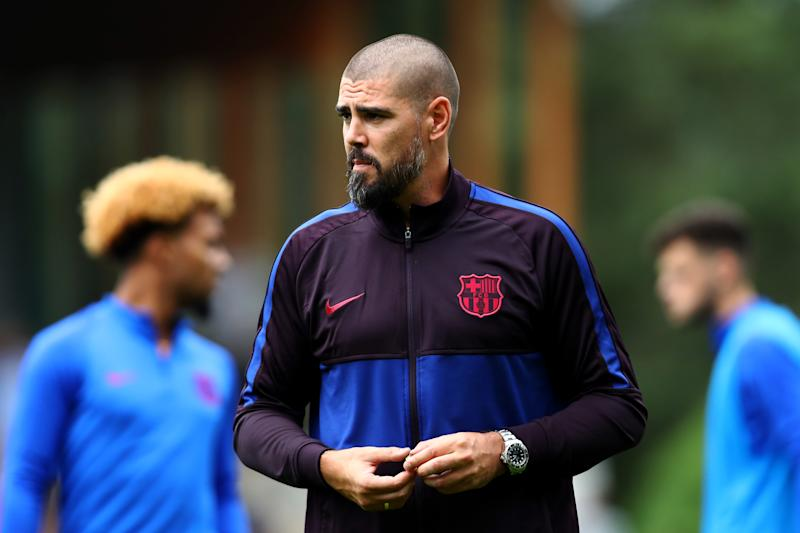EINDHOVEN, NETHERLANDS - AUGUST 17: Victor Valdes, Manager / Head Coach of U19 FC Barcelona gives his players instructions from the sidelines during The Otten Cup match between PSV Eindhoven and FC Barcelona held at De Herdgang, the training ground & youth academy field of PSV Eindhoven on August 17, 2019 in Eindhoven, Netherlands. (Photo by Dean Mouhtaropoulos/Getty Images)