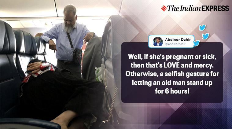 husband stands on flight, husband stands wife could sleep, man stands for wife on plane, viral photo, bizarre news, odd news, indian express