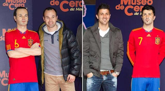 <p>Spain stars Iniesta and Villa pose awkwardly with their prosthetic pals. </p>