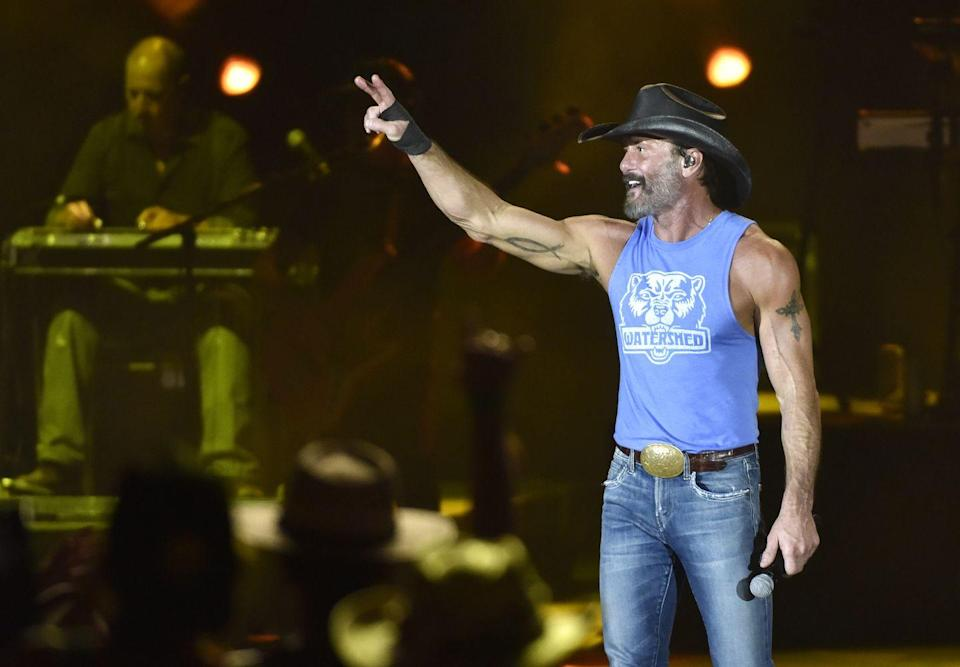 """<p>In 2008, after Tim McGraw's daughter <a href=""""https://www.menshealth.com/fitness/a29622417/tim-mcgraw-workout/"""" rel=""""nofollow noopener"""" target=""""_blank"""" data-ylk=""""slk:showed concern for his health"""" class=""""link rapid-noclick-resp"""">showed concern for his health</a>, the country star decided to make some changes by giving up alcohol and hitting the gym. He told <em><a href=""""https://www.menshealth.com/fitness/a29622417/tim-mcgraw-workout/"""" rel=""""nofollow noopener"""" target=""""_blank"""" data-ylk=""""slk:Men's Health"""" class=""""link rapid-noclick-resp"""">Men's Health</a></em> that he initially started exercising with light walks in the morning, which then progressed into 20-minute runs and eventually turned into lifting weights. """"It wasn't like I was trying to lose 40 pounds, I was just wanting to get healthy,"""" he told <em><a href=""""https://people.com/country/tim-mcgraw-grit-grace-book-announcement/"""" rel=""""nofollow noopener"""" target=""""_blank"""" data-ylk=""""slk:People"""" class=""""link rapid-noclick-resp"""">People</a></em>. """"For me, it is more about feeling good and being where I want to be physically and on stage.""""<br></p>"""
